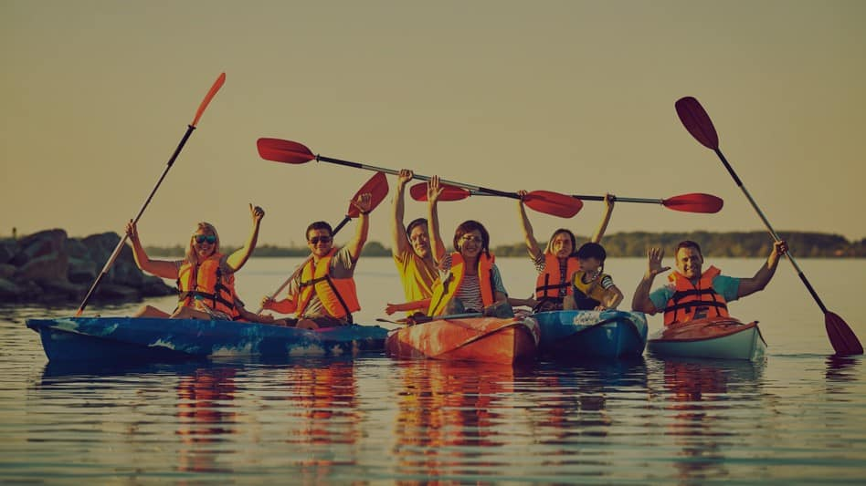 A class is taught to kayak by a trained guide